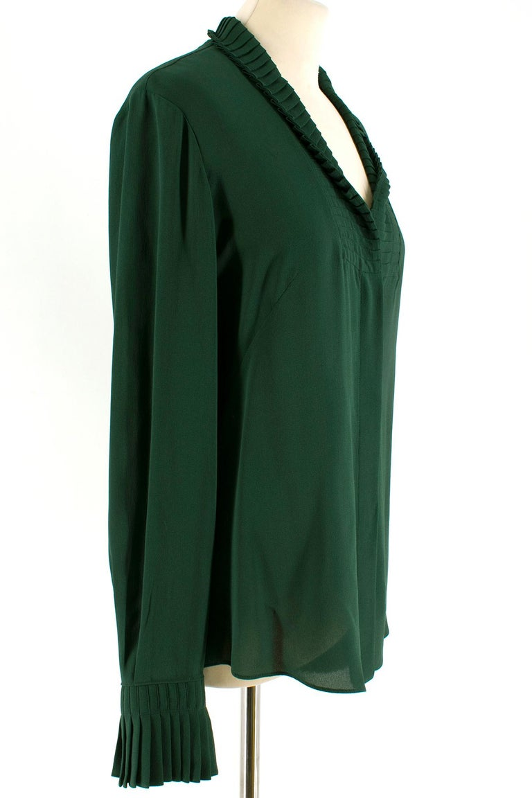 Alexander McQueen Green Pleat Collar Silk Blouse  100% silk; loose fit; pleated details on the sleeves and collar; button closure; Made in Italy   Please note, these items are pre-owned and may show signs of being stored even when unworn and unused.