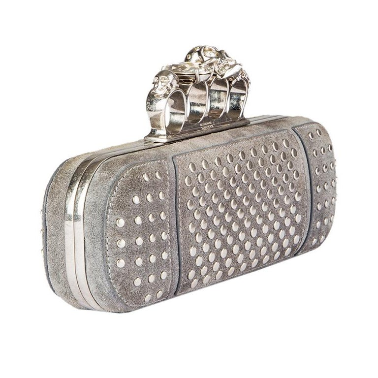 Alexander McQueen 'Studded Four-Ring' clutch in grey suede with antique silver flat studs. Frame-closure with bejewelled skull and giant rhinestone. Lined in black leather. Has been carried and is in excellent condition. Comes with dustbag.  Height