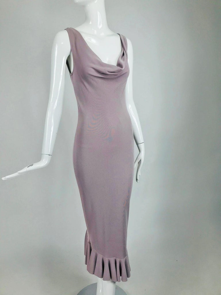 Alexander McQueen lavender knit jersey dress with black ribbon ties at the back. Sleeveless draped cowl neck dress is fitted through the body and falls to a bias cut hem. The dress has a very low back, it closes at the upper and mid back with two