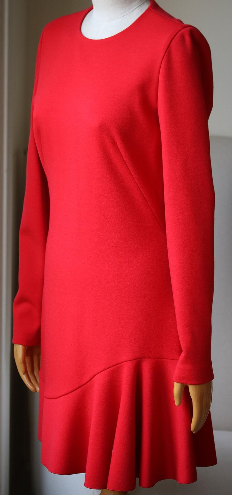 Knitted, lightweight jumper, solid colour, round collar, long sleeves, no appliqués, no pockets, rear closure, zip closure, stretch, dress. 95% Virgin Wool, 5% Elastane. Colour: red.  Size: IT 44 (UK 12, US 8, FR 40)  Condition: As new condition, no