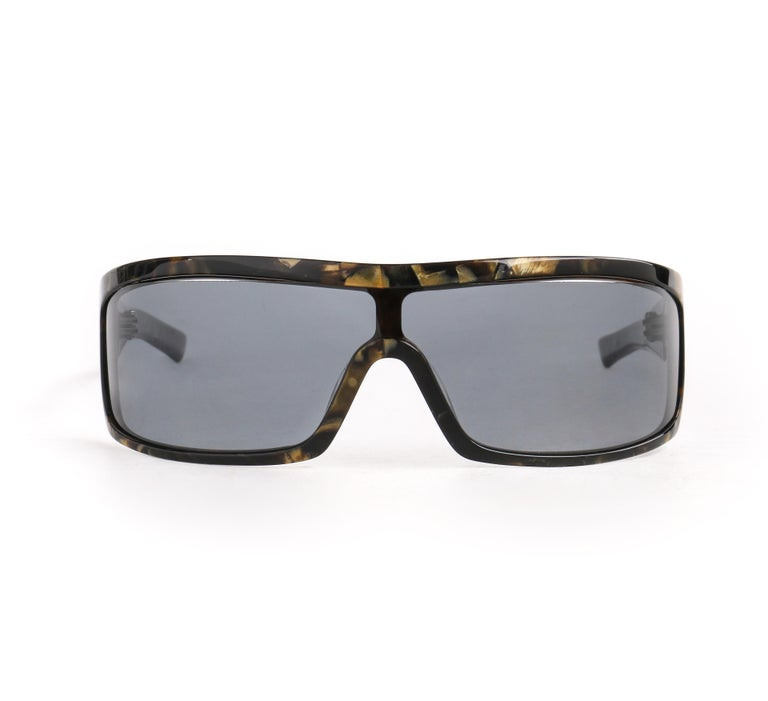 DESCRIPTION: ALEXANDER McQUEEN Metallic Gold Tortoise Shell Shield Sunglasses 4001/S   Brand / Manufacturer: Alexander McQueen Collection:  Designer: Manufacturer Style Name:  Style: Shield sunglasses Color(s): Multi in shades of black and