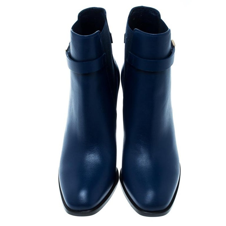 Strut your way in style and dazzle the crowds with these fabulous ankle boots from Alexander McQueen. The midnight blue beauties have been crafted from leather and designed with studs on the 8.5 cm heels. Pair them with a leather jacket and cuffed