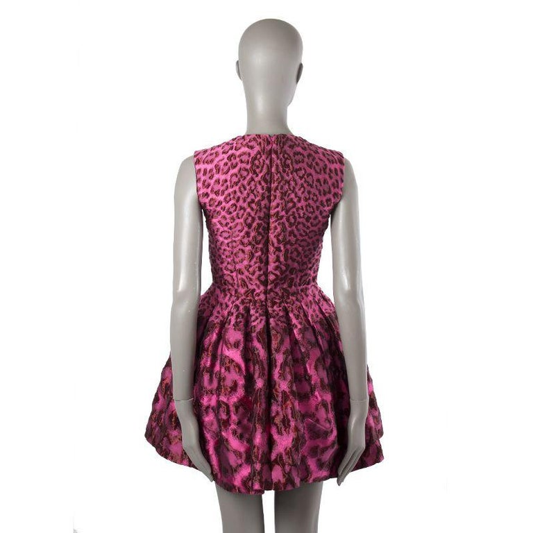 Alexander McQueen brocade leopard pouf dress in pink and red nylon (46%), silk (44%), and acrylic (10%). Closes with invisible back zipper. Lined in black rayon /75%) and silk (25%). Has been worn and is in excellent condition.  Tag Size 38 Size
