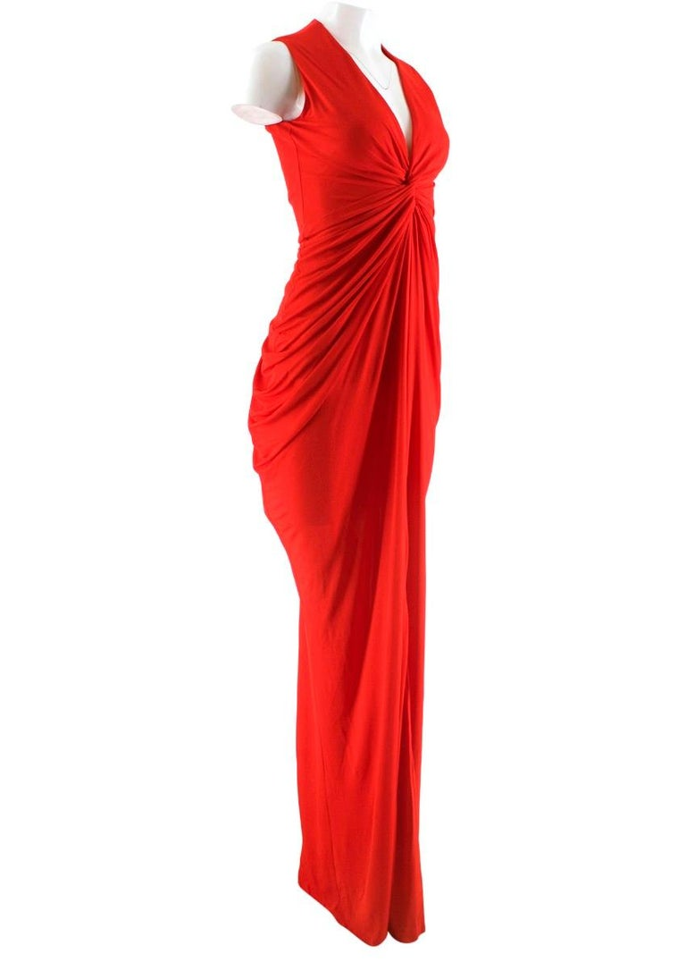 Alexander McQueen elegant long dress featuring a fitted silhouette, sleeveless design and a v-neck.   - Knot-front crepe-jersey gown - Draped sides - Puddle train - Concealed zip and hook fastening at back - 100% viscose Lining:  - 75% polyamide -