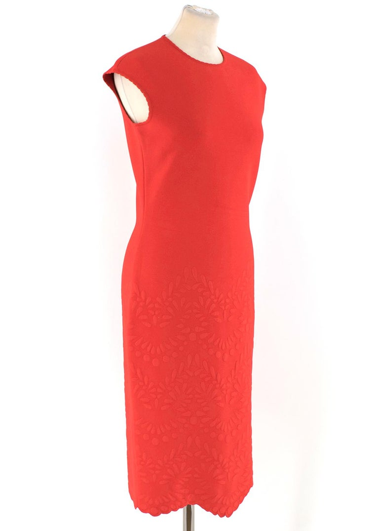 Alexander McQueen Red Jacquard Knit Fitted Dress  -Red, matelasse-jacquard knit dress -Knee length  -Sleeveless -Scalloped hemline -Scoop neckline  Please note, these items are pre-owned and may show signs of being stored even when unworn and