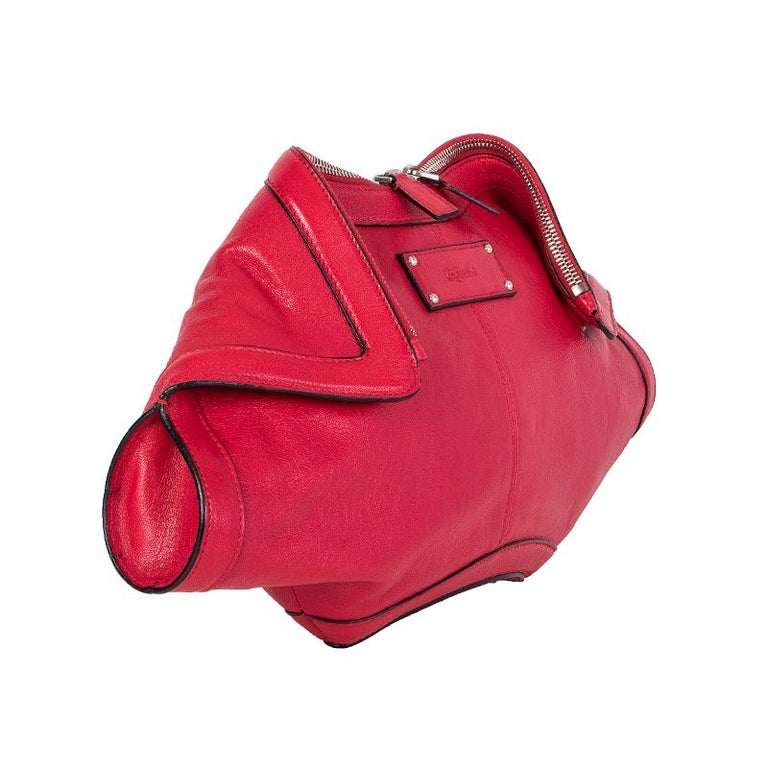 Alexander McQueen 'De Manta' clutch in red leather. Opens with a two-way zipper on top. Lined in black cotton with an open pocket against the back. Has been carried and is in virtually new condition.  Height 20cm (7.8in) Width 38cm (14.8in) Depth