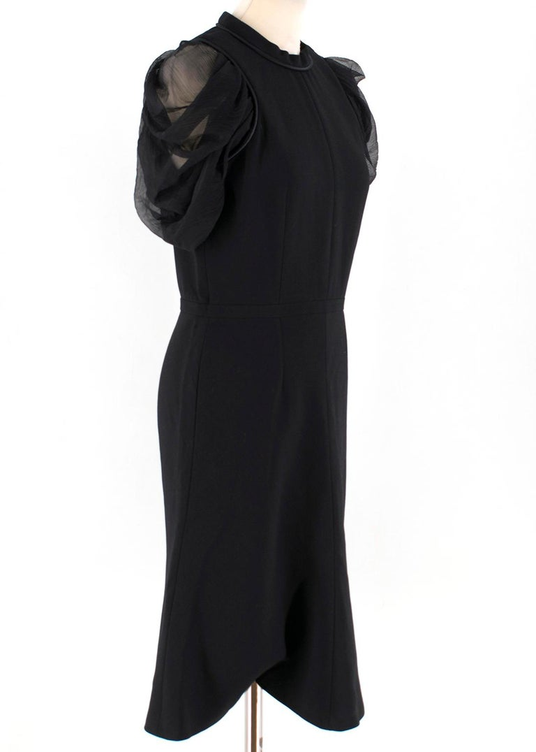 Alexander McQueen Ruffled Chiffon Puff Sleeve Black Dress  - Short transparent bouffant sleeves - Silk detail on the neck and sleeves - Invisible zipper and small hook at the back for closure - Full lining - Darts to the bust for fit  Please note,