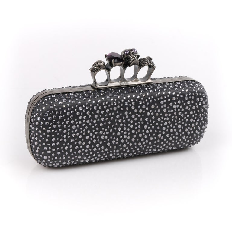 DESCRIPTION: ALEXANDER McQUEEN Silver Grey Swarovski Crystal Embellished Knuckle-Duster Box Clutch    Brand / Manufacturer: Alexander McQueen   Style: Clutch  Color(s): Grey Lined: Yes Unmarked Fabric Content: Satin (exterior); leather (interior);
