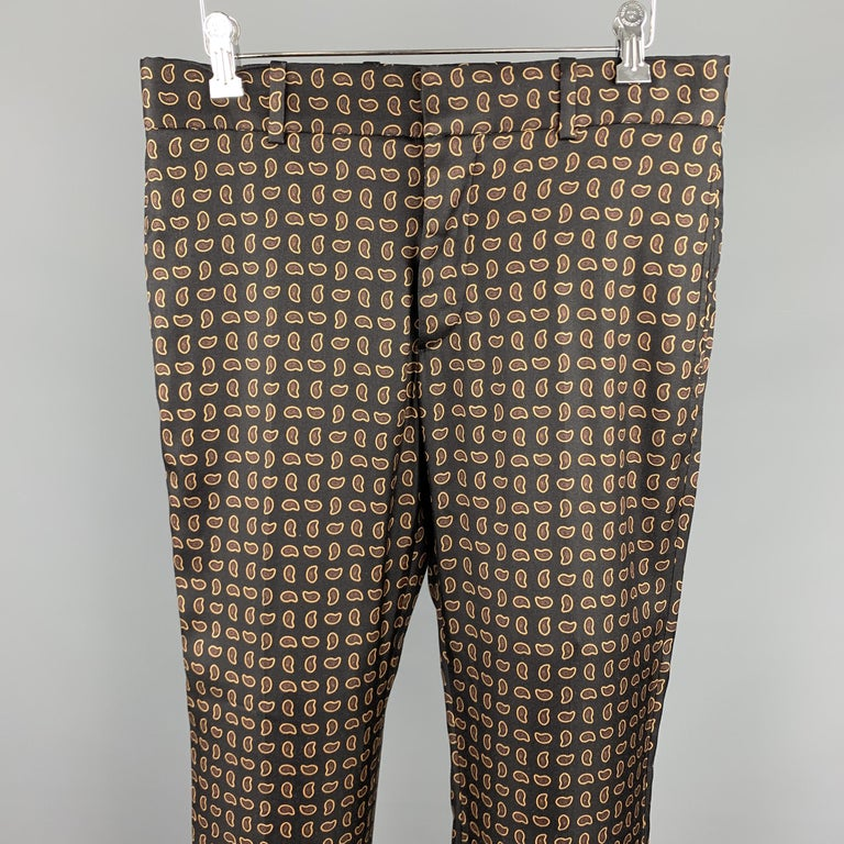 ALEXANDER MCQUEEN casual pants comes in a black wool with a all over paisley print featuring a flat front and a zip fly closure. Made in Romania.  Excellent Pre-Owned Condition. Marked: 46  Measurements:  Waist: 32 in.  Rise: 9 in.  Inseam: 28 in.