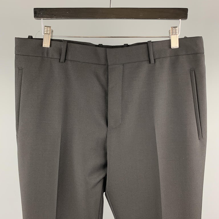 ALEXANDER McQUEEN dress pants comes in a wool / mohair featuring a flat front style, front tab, and button fly closure. Made in Bulgaria.   New With Tags. Marked: EU 50  Measurements:  Waist: 34 in.  Rise: 9.5 in.  Inseam: 36 in