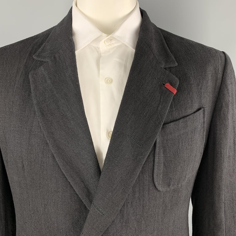 ALEXANDER MCQUEEN sport coat comes in black textured linen with a red tab detailed notch lapel, single breasted, hidden two button front, and  functional button cuffs. Made in Italy.  Excellent Pre-Owned Condition. Marked: IT