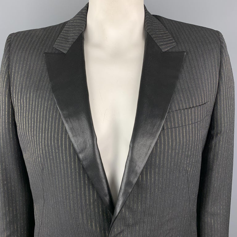 ALEXANDER MCQUEEN sport coat comes in charcoal wool blend fabric with black and gold foil stripes and features a shiny coated peak lapel, single breasted, one button front, and slanted pockets. Made in Italy.  Excellent Pre-Owned Condition.  Marked: