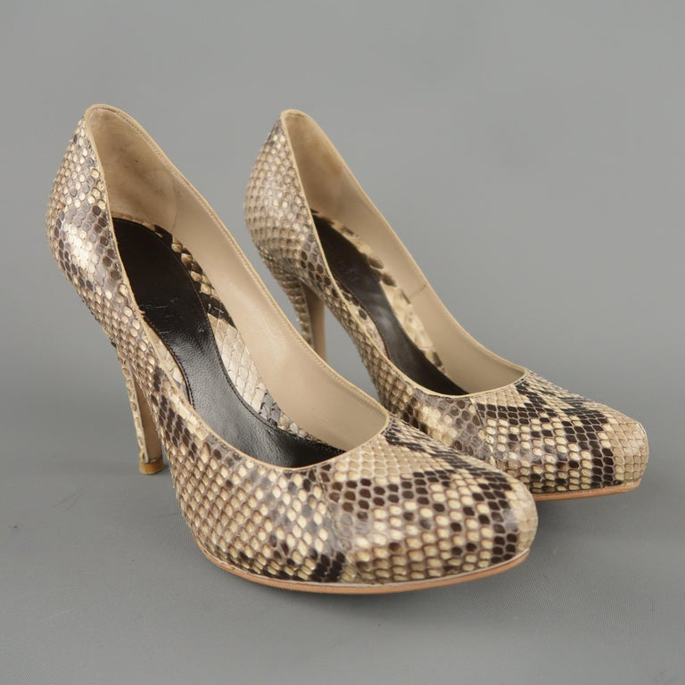 ALEXANDER MCQUEEN pumps come in natural beige python skin leather with a curved hidden platform pointed toe and covered heel. Made in Italy.   Excellent Pre-Owned Condition. Marked: IT 36.5   Measurements:   Heel: 4.25 in. Platform: 0.5 in.