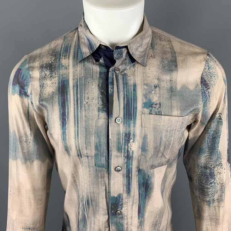 ALEXANDER MCQUEEN Long Sleeve Shirt comes in an abstract print beige and navy cotton material, with a classic collar, a navy trim at inner closure, a patch pocket, buttoned cuffs, button up. Light spot at back of left cuff. Made in Italy.  Very Good