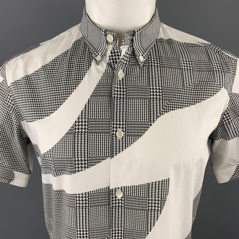 ALEXANDER MCQUEEN short sleeve shirt comes in white cotton with an all over graphic black houndstooth print and button down collar.   Excellent Pre-Owned Condition. Marked: IT 48  Measurements:  Shoulder: 17 in. Chest: 42 in. Sleeve: 8.5 in. Length: