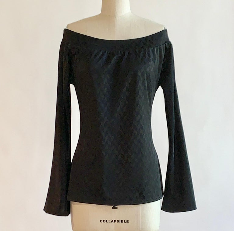 Alexander McQueen black chevron pattern off the shoulder long sleeve top with long bell sleeves. No closure, pulls on.  Seen on the Spring 2000 runway in red, look 56.  100% polyethylene.   Made in Italy.  Labelled size IT 46, usually US 10, but