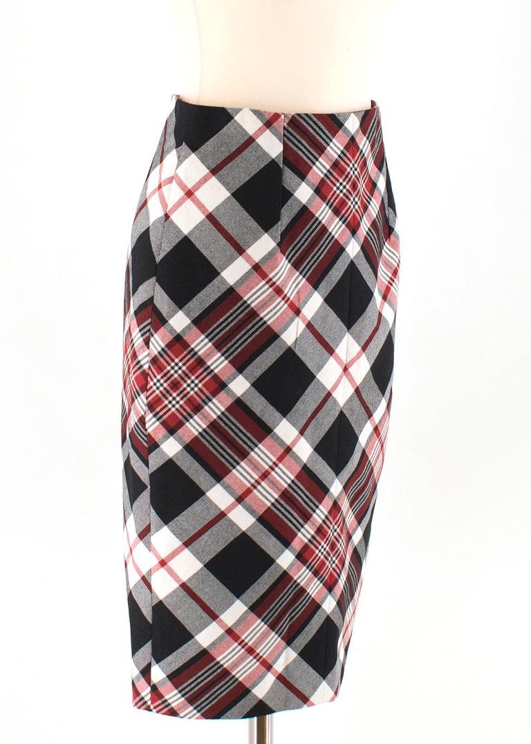 Alexander McQueen Tartan Wool Pencil Skirt  - Pencil shaped skirt - Invisible zipper closure at the back - Vent at the bottom back - 100% Wool - Fully Lined  Please note, these items are pre-owned and may show signs of being stored even when unworn