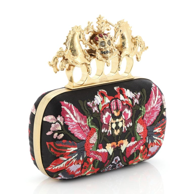 This Alexander McQueen Unicorn Skull Knuckle Box Clutch Embroidered Mesh Small is the perfect evening accessory for your nights out. Crafted in black embroidered mesh, features picturesque unicorn skull four-finger knuckle ring handle embellished