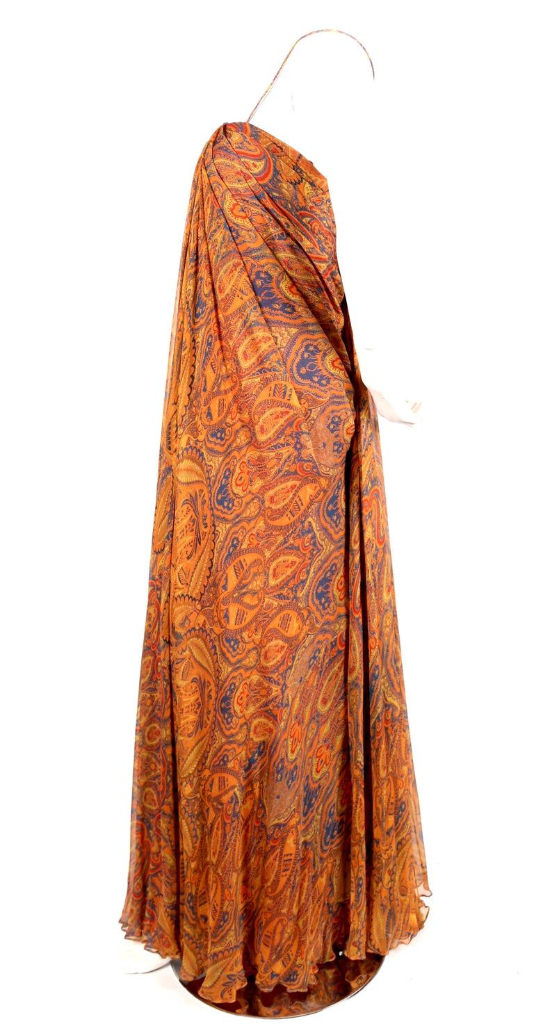 Beautiful, paisley printed, silk-chiffon, floor-length dress from Alexander McQueen dating to 2009. Dress is labeled an Italian size 44 however this dress runs small and would better suit an Italian 40 or 42 (US 4-6) or 34