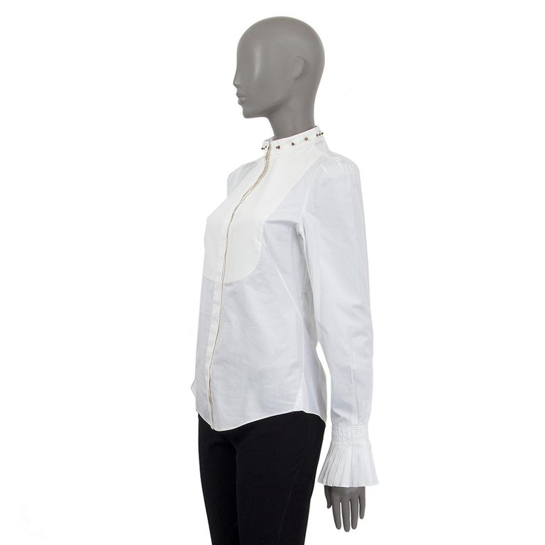 Alexander McQueen long sleeve panel detail blouse in white and off-white cotton (100%) with an embellished band collar. Has flared pleated cuffs. Closes on the front with buttons. Unlined. Has been worn and is in excellent condition.   Tag Size