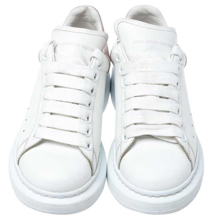 These sneakers from Alexander McQueen are so chic, you'll love wearing them for your fun outings with friends! The white sneakers are crafted from leather and feature round toes. They flaunt lace-ups on the vamps and a suede panel on the counters.