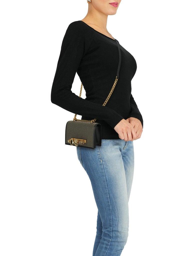 Bag, leather, solid color, iconic detail, internal logo, button fastening, adjustable shoulder strap, gold-tone hardware, internal card slot, jewel embellishment, rockstud embellishment, evening, occasion wear, mini bag  Includes: - Dust bag -