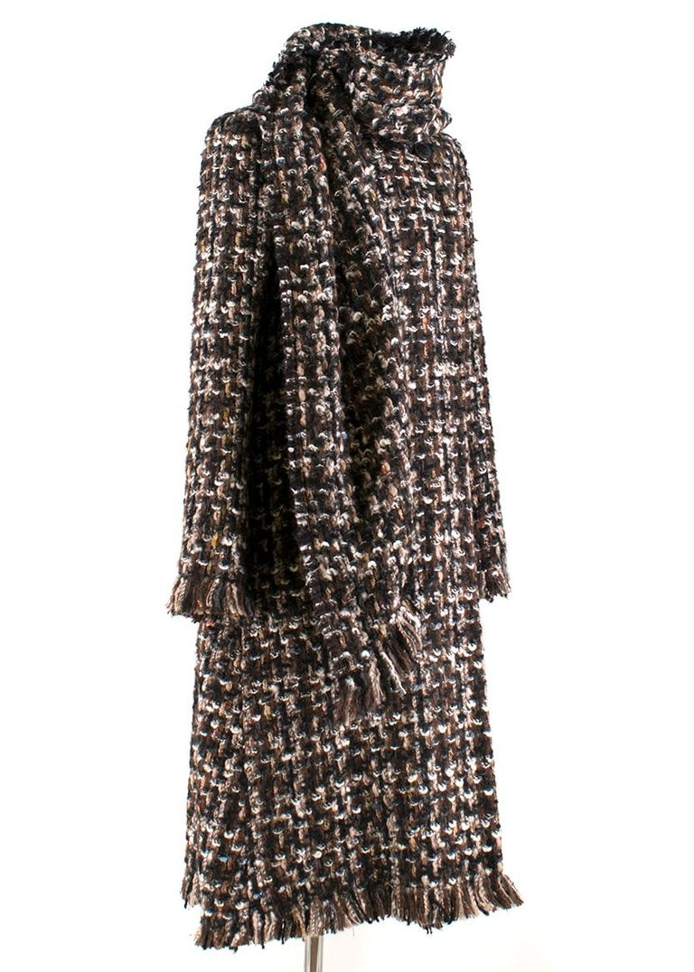 Alexander McQueen Wool Braided Long Coat   -Brown, heavy weight, unknown wool blend -Black, brown, pink braided fabric  -Fringe detail on cuffs and hem -Single double breast button fastening (near neckline)  -Two centre hidden snap