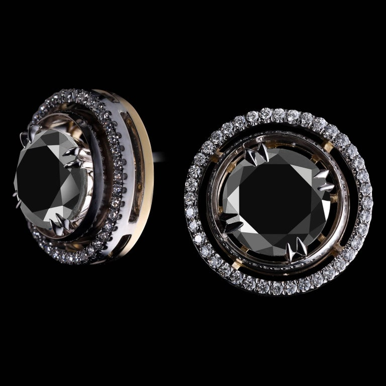 A pair of Round Black Diamond Cuff Links featuring Round Black Diamond Centers weighing 4.34 carats total detailed with 78 1mm signature floating Diamond melee and knife-edged wire. Cuff Links measure 1/2 inch in diameter and are set in Platinum