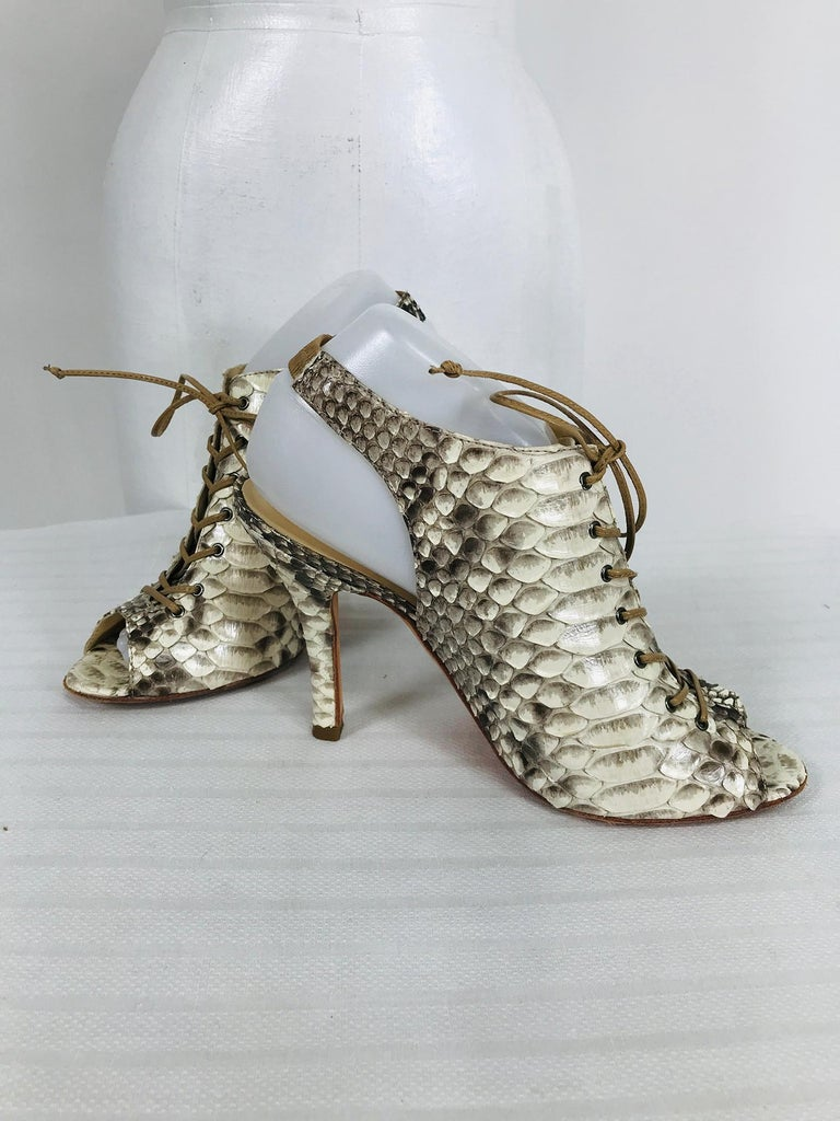 Alexandre Birman python, snake skin, laced front, open toe, sling back, high heels marked size 9B. Fabulous shoes in very good, barely worn condition. Leather laces close at the front, open peep toes and cased elastic sling back heels. High skinny