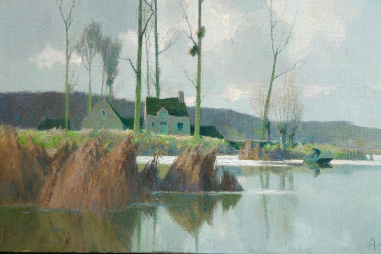 A superb oil on canvas circa 1930 by French Impressionist painter Alexandre Louis Jacob depicting figures on a riverbank by a cottage on a bright dat. Signed lower right, titled and with original exhibition label verso.  Dimensions: Unframed: