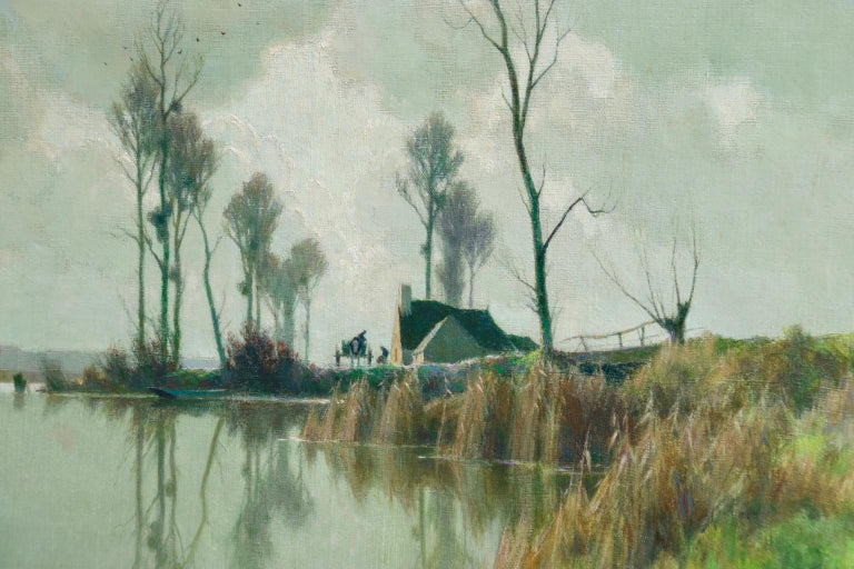 A superb oil on canvas circa 1920 by French Impressionist painter Alexandre Louis Jacob depicting figures on a riverbank by a cottage on a cool, still day in winter. Signed lower left.  Dimensions: Unframed: 18