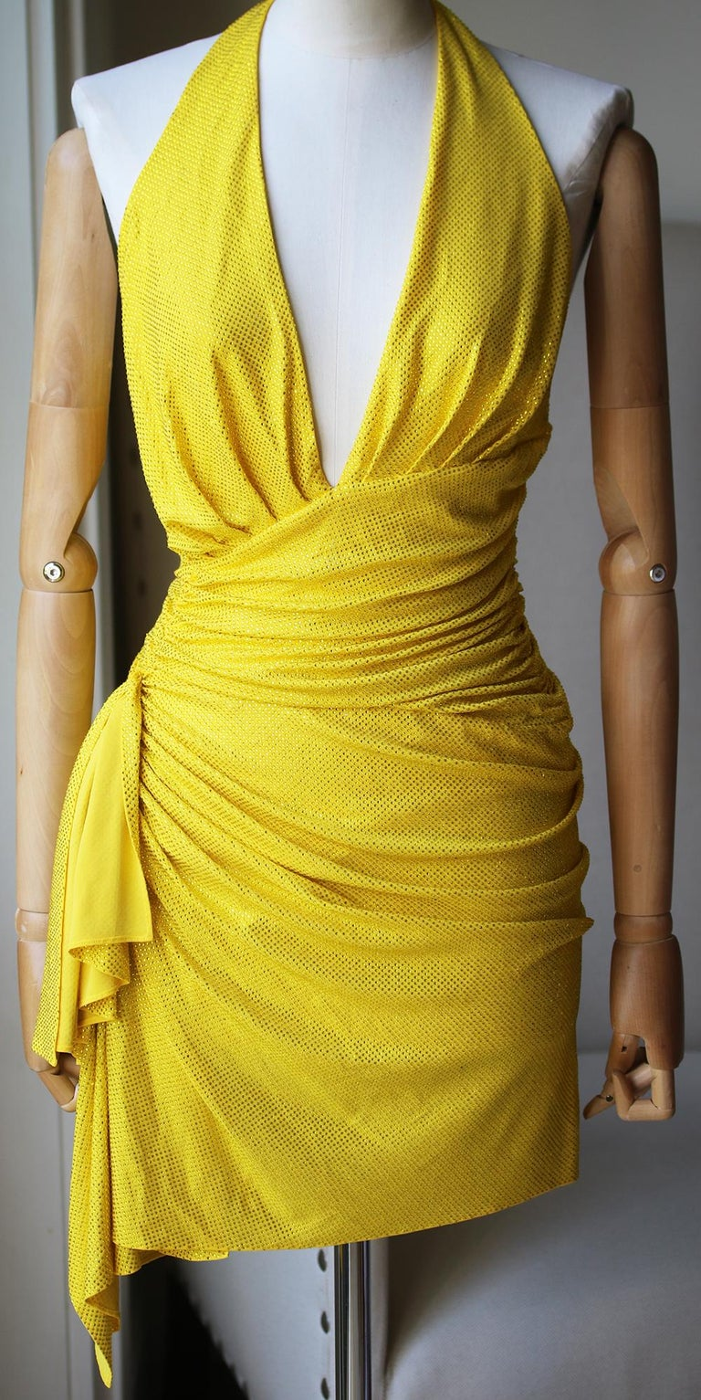 Crossover neckline. Microcrystal embellished accents throughout. Ruched side detail with draped fabric accent. Fully lined. Colour: yellow. Made in Italy. 92% viscose, 8% elastane.   Size: IT 38 (UK 6, US 2, FR 34)  Condition: As new condition, no