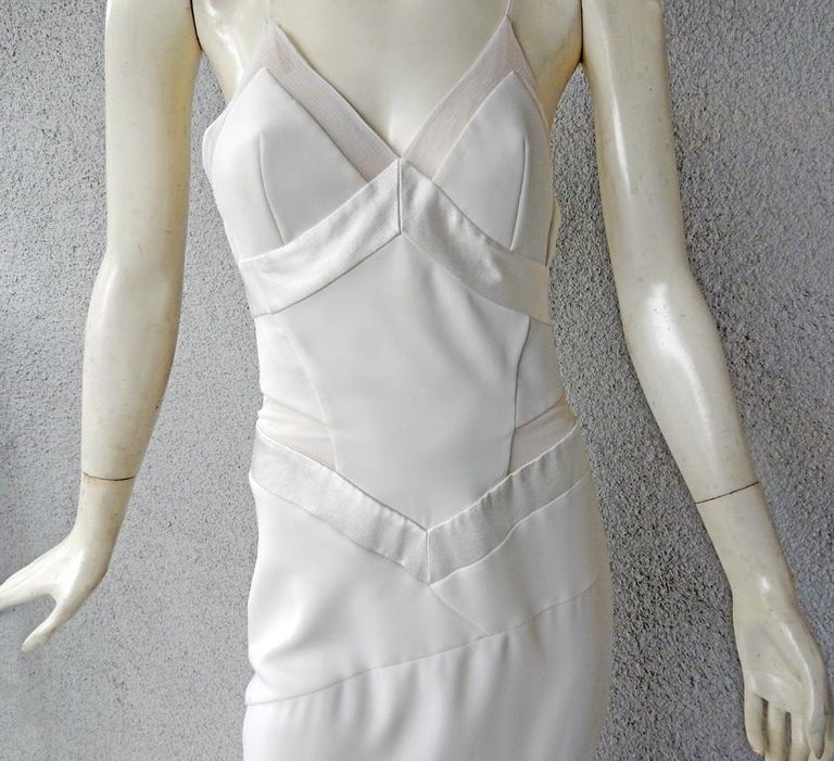 Alexandre Vauthier seductive off white form fitting gown in brand new condition.   Spaghetti strap bodice bias cut dress with high front front slit.  Sheer inset.  Sophisticated skirt tailoring constructed in panels.  Fully lined; back zipper