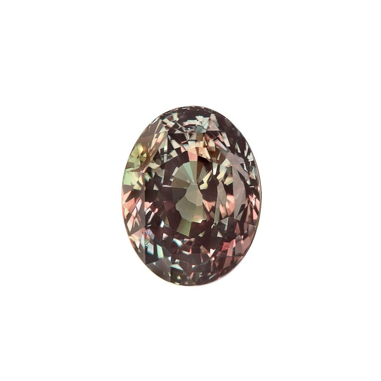 Rare and unique 3.40 carat Alexandrite oval gem, displaying a phenomenal color change. The GIA certificate is attached to the images for your reference. This collection quality gem is offered loose and would make an exceptional unisex custom made