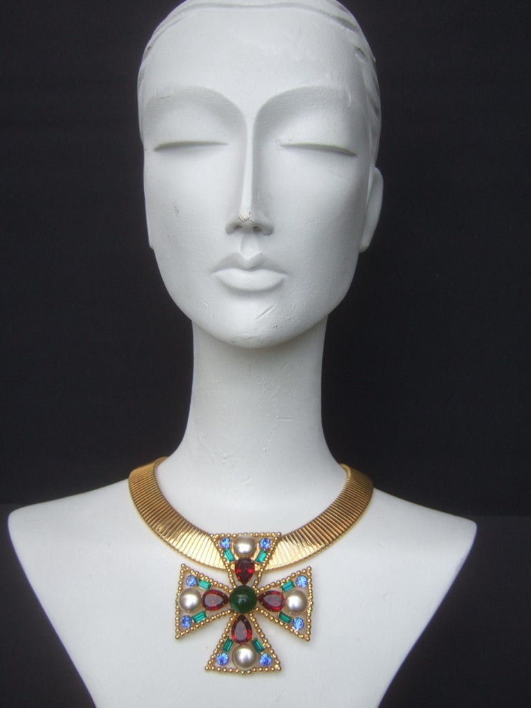 Alexis Kirk Massive glass jeweled maltese cross choker necklace The wide gilt metal stretch choker is adorned with a large scale  maltese cross glass stone stationary pendant  Makes a very dramatic eyecatching necklace Designed by Alexis Kirk