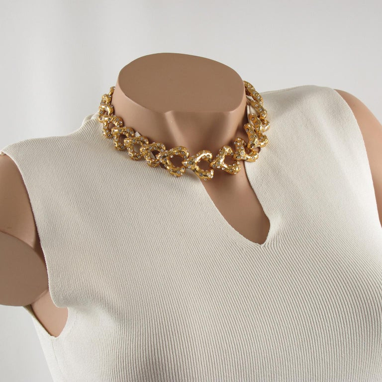 Lovely French designer Alexis Lahellec Paris signed choker necklace. Elegant freeform dimensional heart shape, gilt metal all textured paved with tiny clear crystal rhinestones. Fold-over closing clasp. Signed at the clasp with tiny gilded tag