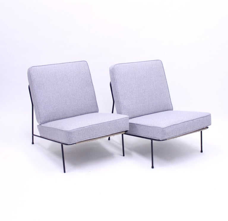 Pair of lounge chairs designed by Alf Svensson for DUX / Ljungs Industrier and their furniture line Bra Bohag in the 1950s. The model was shown at the very well known H55 exhibition in 1955 in Helsingborg, Sweden which is one of the highlights of