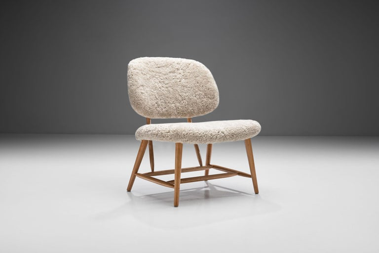 """This """"TeVe Stol"""" or """"The TV chair"""" was designed in 1953, during the most active period of Swedish furniture designer Alf Svensson. This chair is a piece that is typically designed in the Scandinavian modern style.  The chair's simple and"""