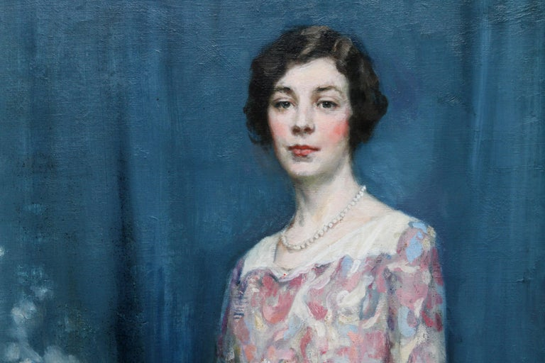 This lovely Scottish Colourist portrait oil painting is by noted prolific Scottish exhibitor Alfred Edward Borthwick. The full length portrait, circa 1920's is of a beautiful woman in a floral dress against a blue background. There is superb