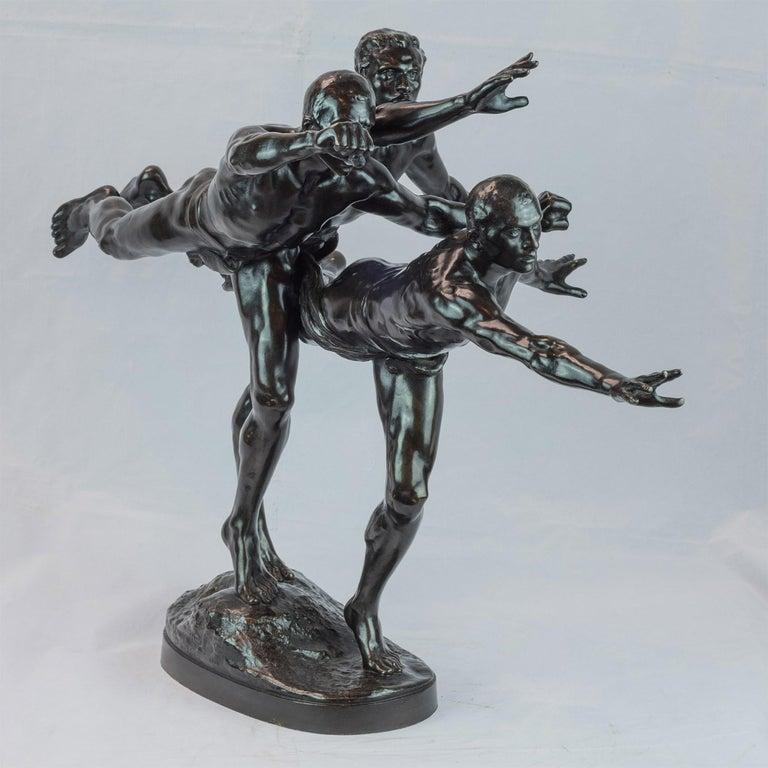 Patinated bronze figural group sculpture entitled