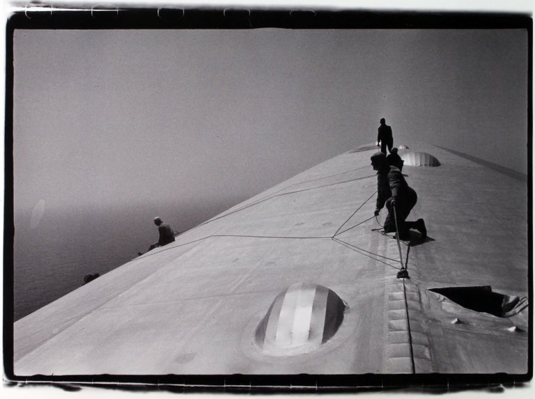 Alfred Eisenstaedt Black and White Photograph - Repairing The Hull Of The Graf Zeppelin During The Flight Over The Atlantic