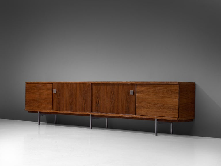 Alfred Hendrickx for Belform, large sideboard in rosewood, Belgium, 1960s. Measures: 3.4mtr/134in  This sideboard is designed by the Belgian designer Alfred Hendrickx. This credenza features four doors and one sliding door with characteristic