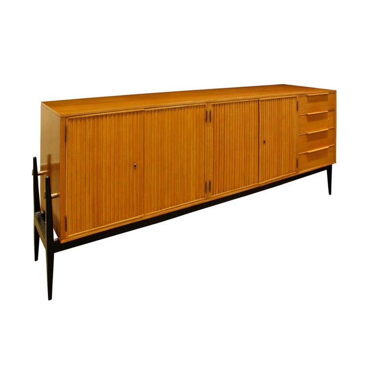 Credenza with 4 fluted doors 4 drawers on the right in fruitwood on an ebonized base by Alfred Hendrickx, Belgium 1950s. This piece is beautifully crafted and very elegant.