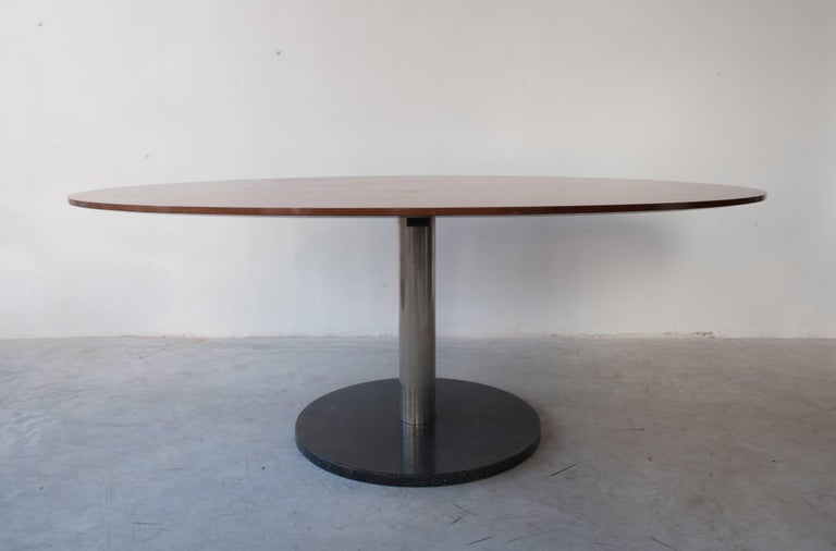 Dining table in walnut, chrome tube, and black marble base by Alfred Hendrickx for Belform, Belgium, 1960s. Oval shaped dining room table featuring a beautiful grain in the walnut veneer on a chromed frame and black marble base. This table is