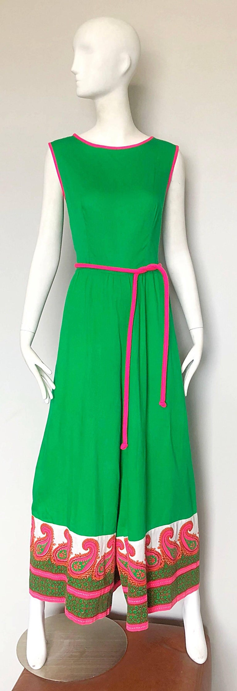 Rare 1960s ALFRED SHAHEEN kelly green and hot pink  screen printed wide leg jumpsuit! Features shamrock kelly green with hot pink trim around the neck and sleeves, with a matching detachable tie belt. Hot pink, white and green paisley screen print