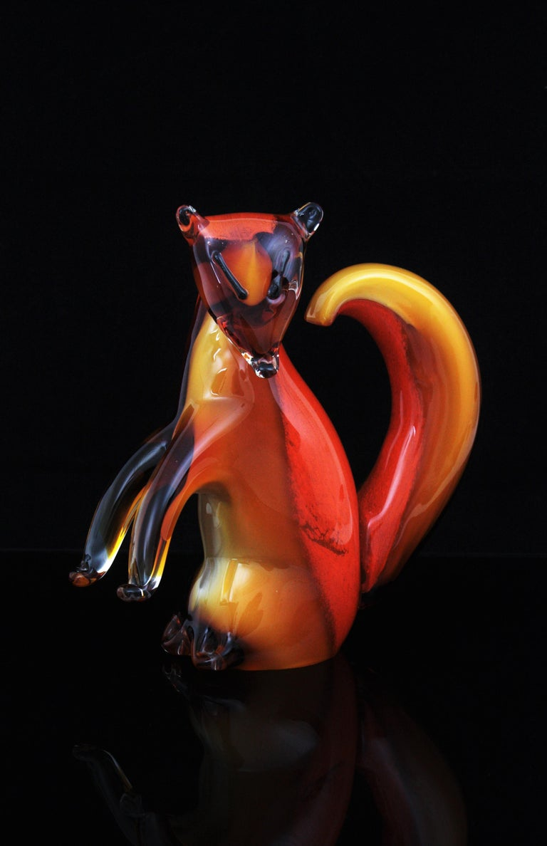 One of a kind large hand blown Sommerso and Lattimo amber, orange, white and clear glass squirrel sculpture.
