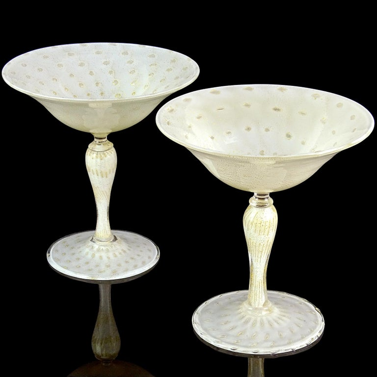 Priced per item. Beautiful Murano hand blown white, controlled bubbles and gold flecks Italian art glass pedestal compote bowl. Documented to designer Alfredo Barbini for Salviati, circa 1950s. Profusely covered in gold leaf inside and out, and with