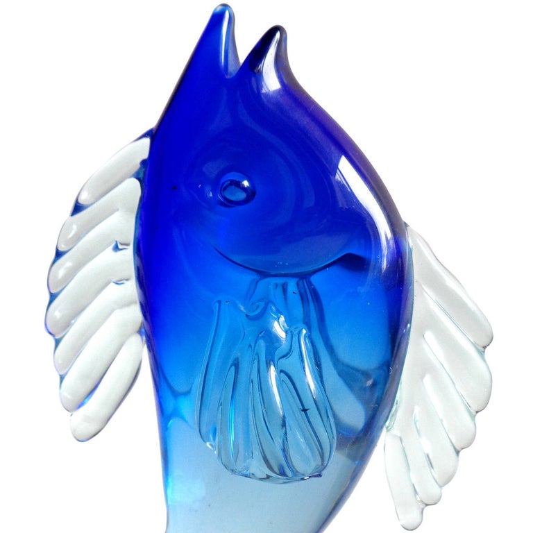Priced per item, Murano hand blown Sommerso cobalt blue and green Italian art glass fish sculptures. Documented to designer Alfredo Barbini. The green fish has 2 original labels, including one with