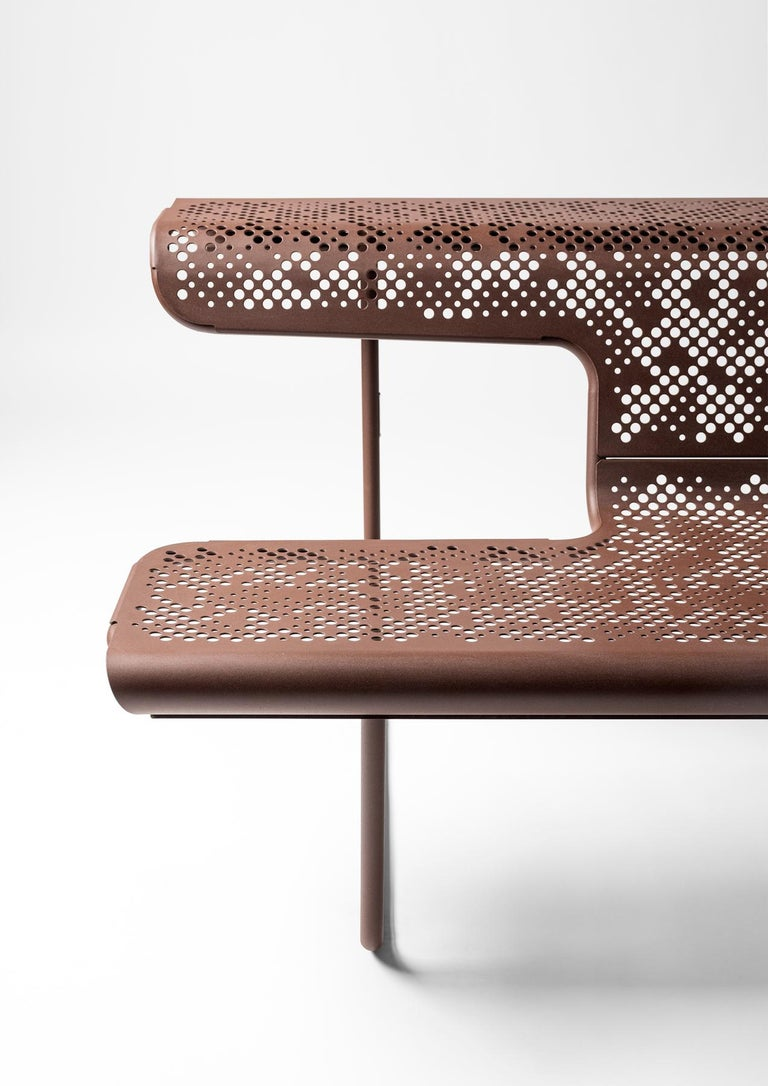 Interior and exterior bench designed by Alfredo Häberli. Manufactured by BD Barcelona (Spain).  Steel tube legs and perforated steel sheet seats with a cataphoresis covering and painted with a polyester resin, in either bronze or silver