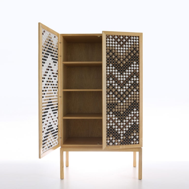 The mousharabiyeh-inspired doors of the Ali Baba cabinet are constructed with traditional technique re-appropriated in modern material, with each piece set by hand and X-ed with acrylic joints.